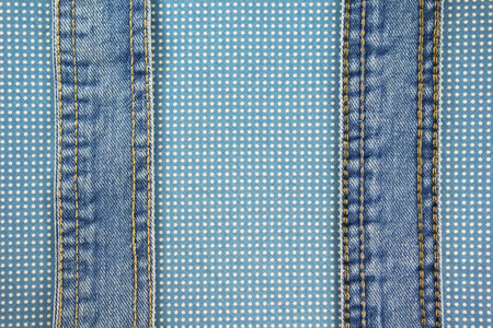 Jeans with stitch on blue dot cloth texture and background photo