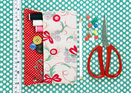 polka dot fabric: Sewing kit on polka dot fabric background