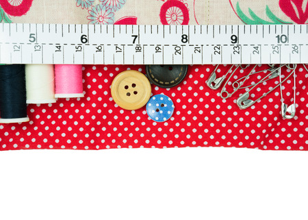 Sewing kit in handmade fabric bag with measuring tape photo