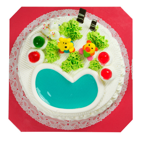 fancy pastry: Fancy cake with sugar cartoon and jelly heart isolated on white background