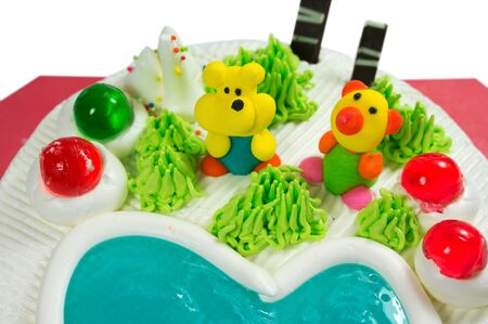 buttercream: Fancy cake with sugar cartoon and jelly closeup Stock Photo