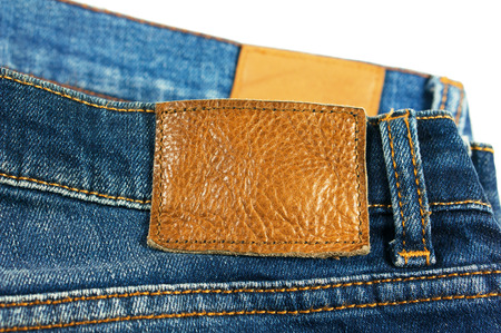 Jeans with brown leather label isolated on white background photo