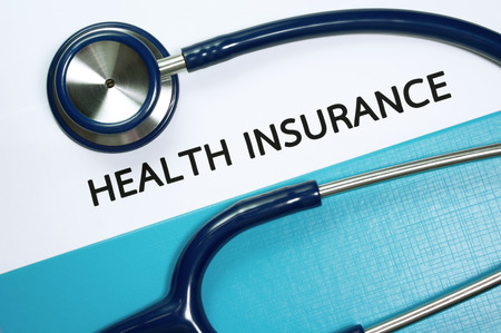 Health insurance document in folder with stethoscope