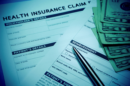 Health insurance claim form with stethoscope for insurance concept