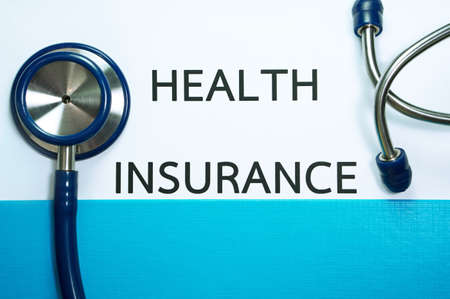 reimbursement: Health insurance document in folder with stethoscope