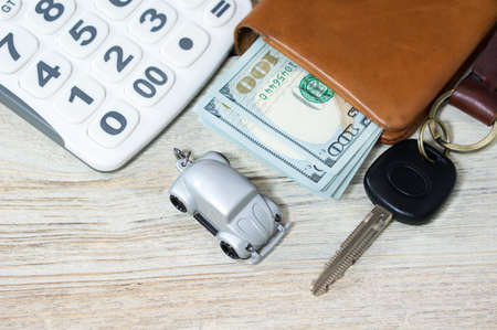 Car toy and key with calculator and money photo