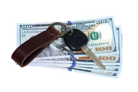 reimbursement: Car key on money isolated on white background
