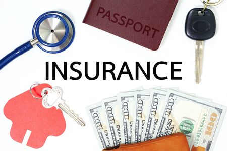 Insurance concept with money and many types of insurance photo
