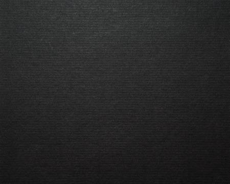 Zwarte kartonnen papier achtergrond en textuur