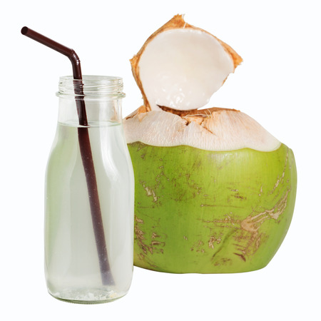 Coconut water fruit drink in glass bottle isolated on white background