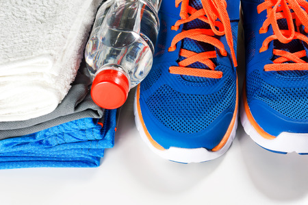 athletic wear: Fitness accessories with sport shoes and clothing drinking water and towel