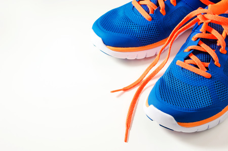 Blue sport running shoes with orange shoelace