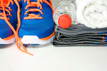 athletic wear: Fitness accessories with running shoes sport clothing drinking water and towel Stock Photo
