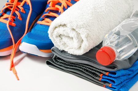 in towel: Fitness gym accessories with sport clothing towel drinking water and running shoes Stock Photo