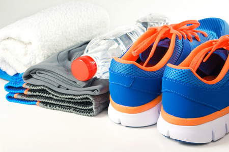 Fitness accessories with sport shoes and clothing Standard-Bild