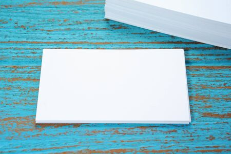 businesscard: Blank business card on blue wood desk