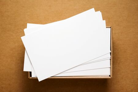businesscard: Business cards in box on kraft cardboard background Stock Photo