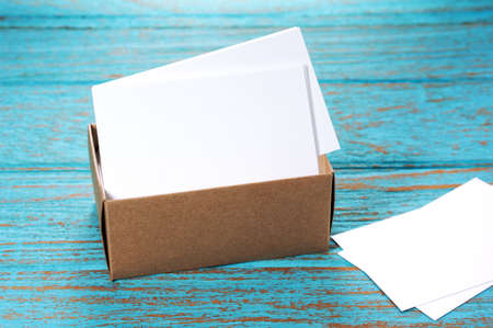 businesscard: Business cards in brown paper box on wood desk