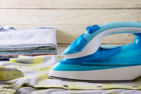 Ironing clothes laundry housework with shirts and iron