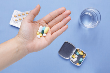 hand holding pills: Hand holding pills and capsule Stock Photo