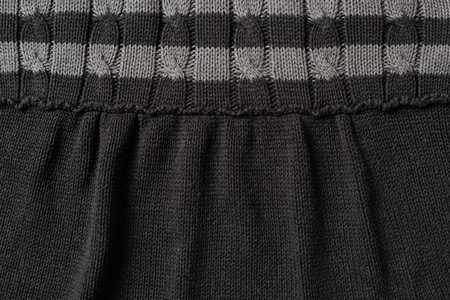 texture cloth: Knit wool clothing in grey texture background
