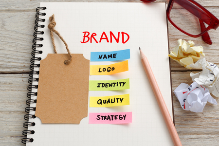 Brand marketing concept with notebook, brand tag and coffee cup on work desk