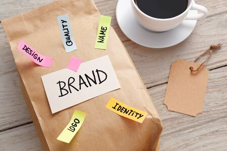 Branding marketing concept with kraft paper bag, brand tag and coffee cup