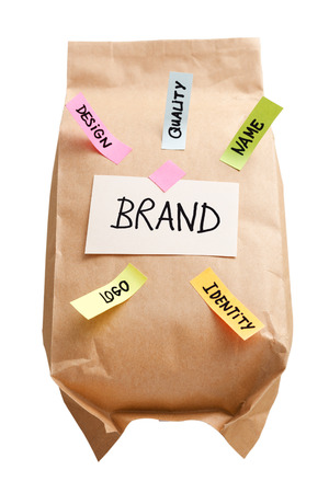 Paper bag with branding marketing concept isolated on white background