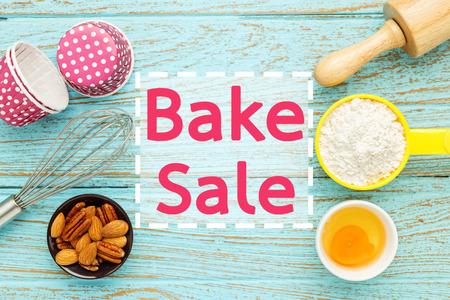 Bake sale with baking ingredients on wood table Standard-Bild