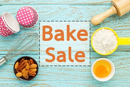 bake sale: Bake sale background with baking ingredients on wood table
