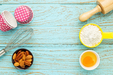 Bake background with baking ingredients on wood table Stock Photo