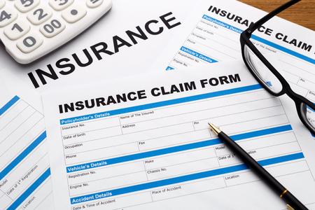 reimbursement: Insurance claim form with pen and calculator Stock Photo