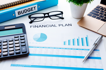 Financial and budget planning concept with calculator laptop and finacial report Stock Photo