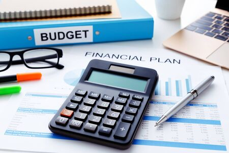 finacial: Financial and budget planning concept with calculator laptop and finacial report Stock Photo