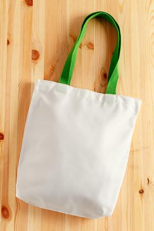 White fabric bag on wood background 版權商用圖片