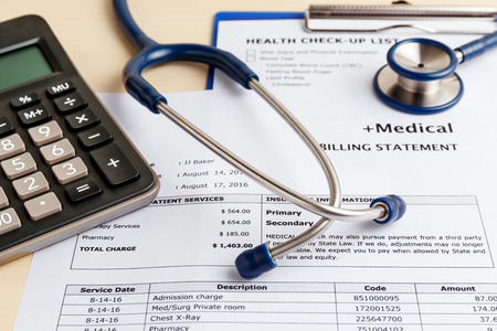 Medical cost concept with calculator and stethoscope