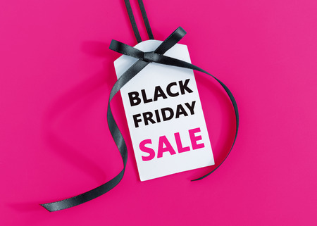 Black friday sale tag with black ribbon