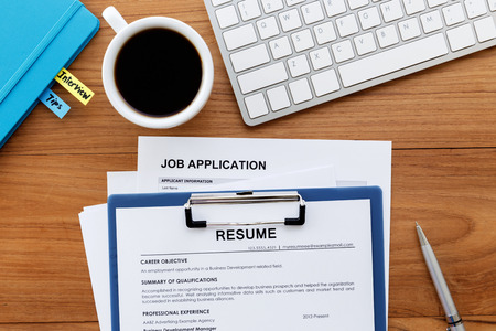 Job search with resume and job application on computer work desk Standard-Bild