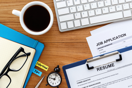 Job search with resume and job application on computer work table background