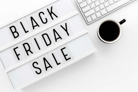 Black friday sale word on lightbox with computer keyboard on whtie table with space