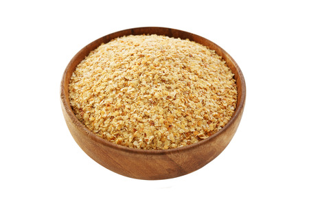 Wheat germ in bowl isolated on white background