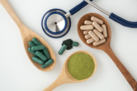 Herbal medicine in capsules with stethoscope