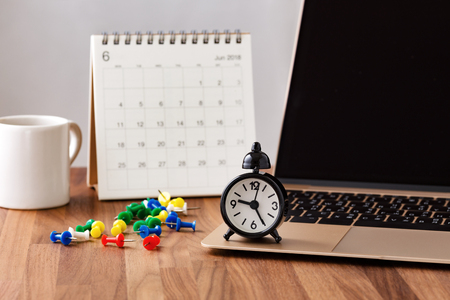 Time management concept with calendar, pins and clock on computer