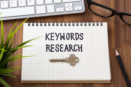 Keywords research for seo concept with computer