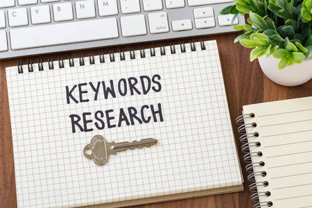 Keywords research for seo concept on wooden desk Stock Photo