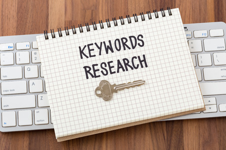 Keywords research for seo concept with key and computer keyboard
