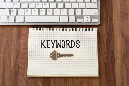 Keywords word with key on notebook with computer keyboard Stock Photo