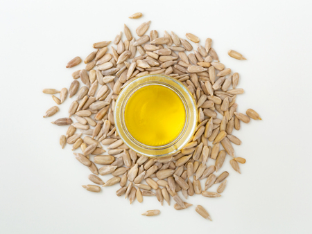 Sunflower oil in glass bottle with seeds on white background, top view Stock Photo