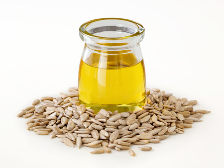 Sunflower oil in glass bottle with seeds isolated on white background Stock Photo