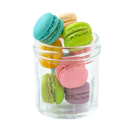 Macaroons in glass bottle isolated on white background